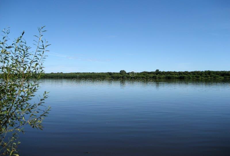 Azul do céu e da água imagem de stock