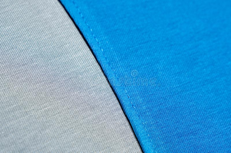 Azul e Grey Fabric Seam Swatch Emenda do t-shirt azul imagem de stock royalty free