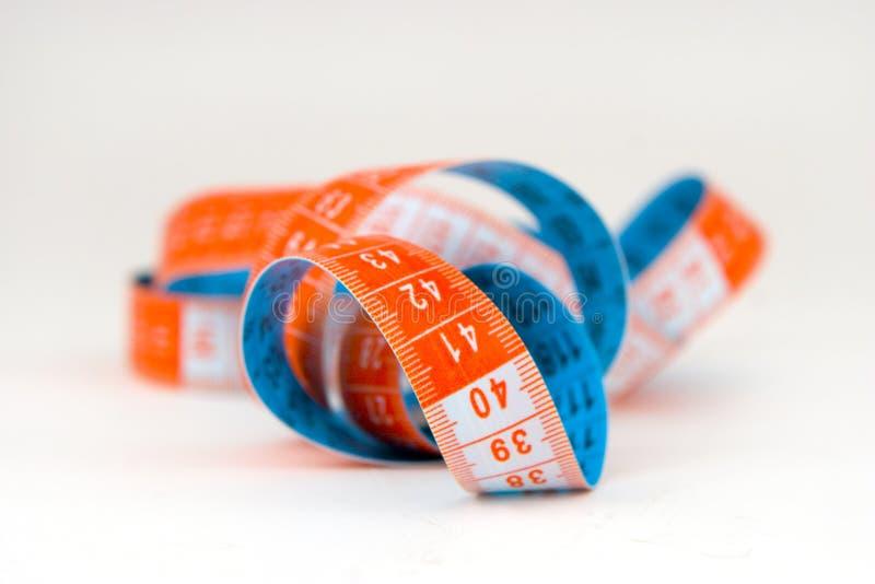 Azul y cinta de medición anaranjada foto de archivo
