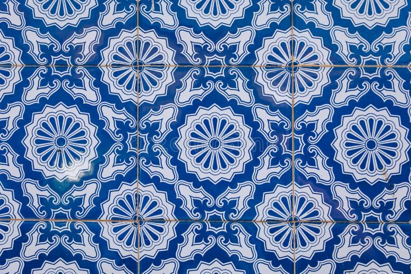 Azulejo is a form of Portuguese or Spanish painted, tin-glazed, ceramic tile work. Azulejos is traditional Portugese tiles in. Aveiro. Architecture ornament royalty free stock images