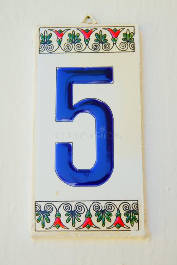 Azulejo numerado decorado com imagens da flor imagens de stock royalty free
