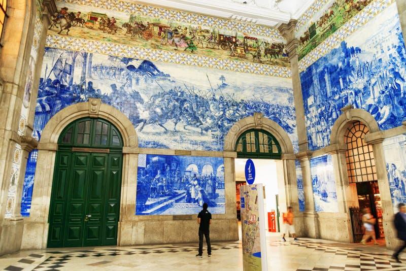 Azulejo panels on walls of main hall inside of the Sao Bento Railway Station in Porto city royalty free stock photos