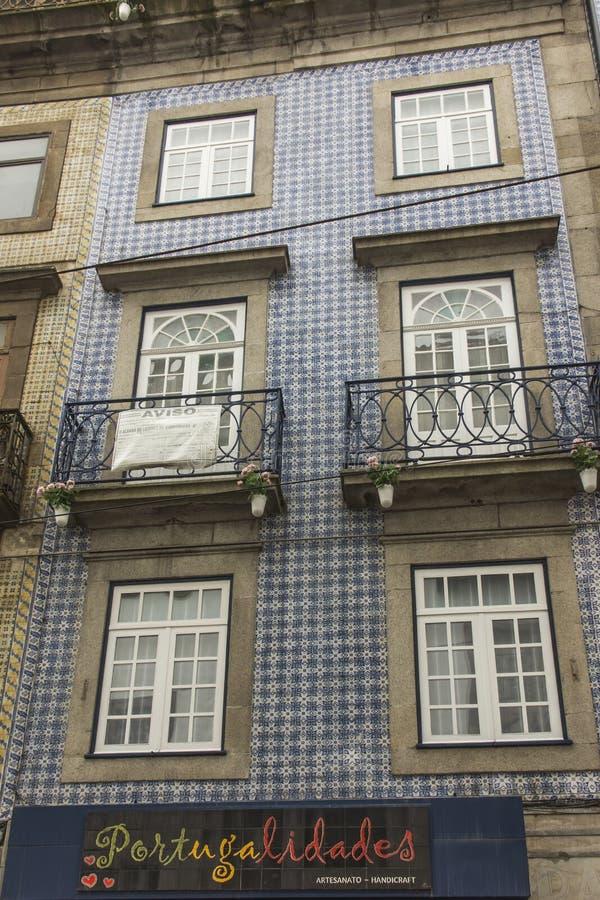 Azulejo tiles on the building facade typical finish of buildings. Azulejo tiles on the building facade typical finish of many buildings in Portugal royalty free stock photos