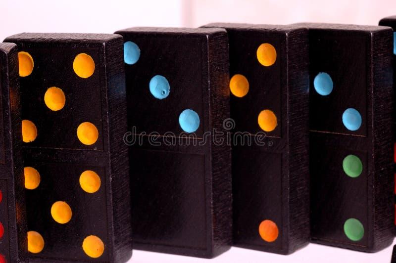 Azulejos coloreados del dominó foto de archivo
