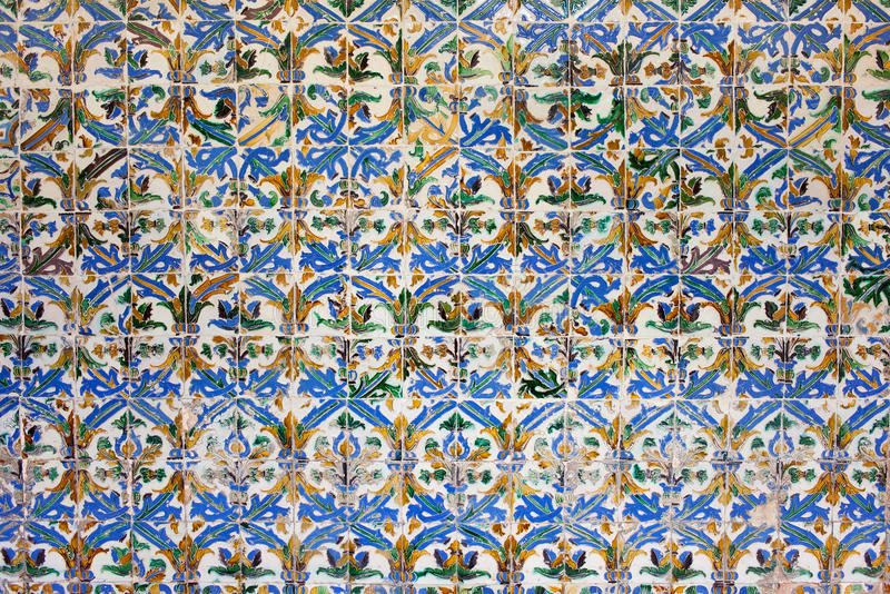 Azulejos Tiles in Mudejar Style Background. Old, historic Azulejos tiles in the Mudejar Style, Real Alcazar, Seville, Spain, Andalusia region stock photos