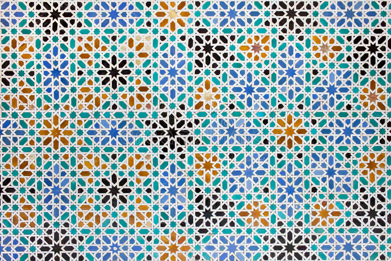 Azulejos Tiles in Mudejar Style Background. Azulejos tile work in the Mudejar Style, old historical background in the Real Alcazar, Seville, Spain, Andalusia royalty free stock images