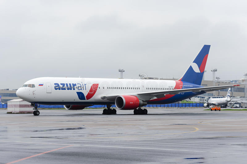 Azur Air Airline Boeing 767-300. MOSCOW, RUSSIA - MAY 19, 2016: Azur Air Airline Boeing 767-300 aircraft parked at Domodedovo International airport. Rainy and royalty free stock photo