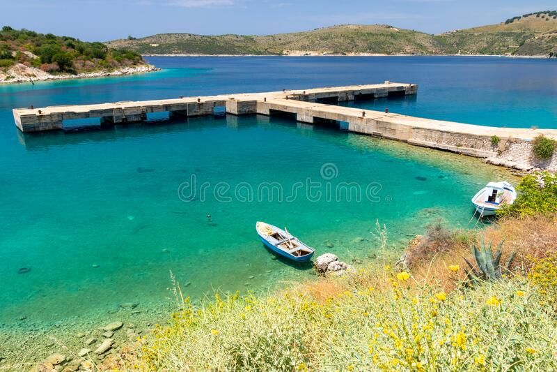 Azure bay in Porto Palermo near Himare in Albania stock photos