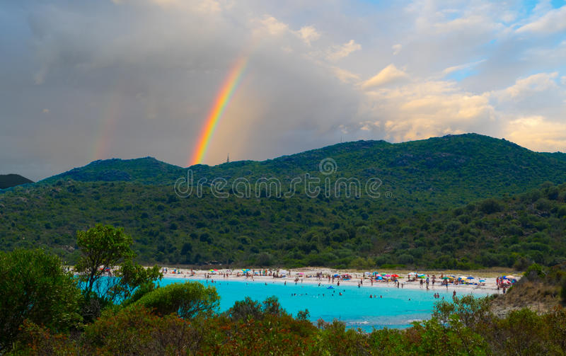 Azure bay and rainbow in Corsica, France royalty free stock photos