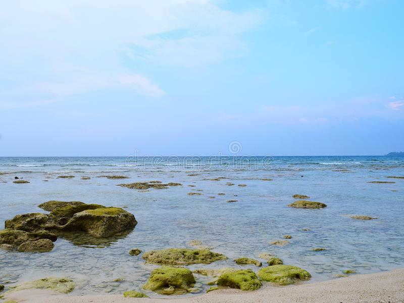 Azure Clean Sea Water with Underwater Stones and Blue Sky - Natural Background - Neil Island, Andaman Nicobar, India royalty free stock photos