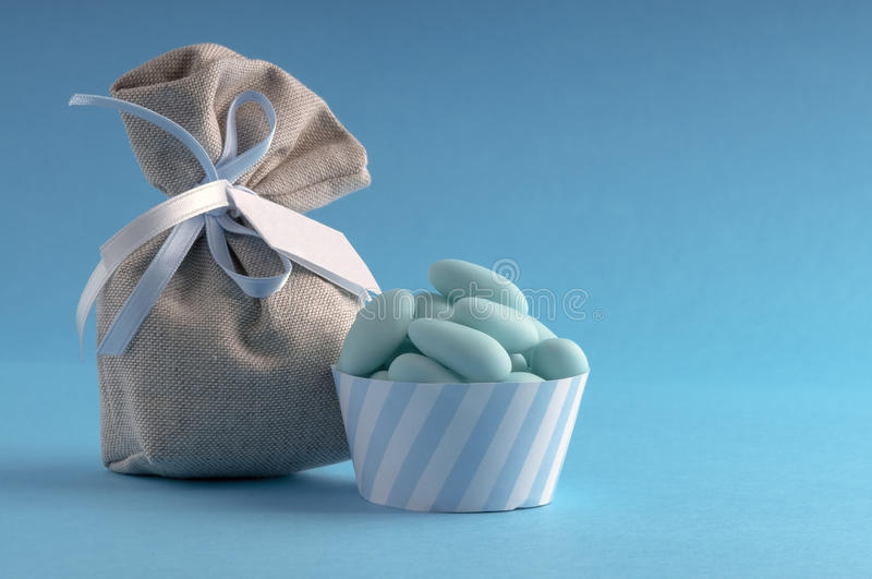 Azure dragee withe little bag stock photos