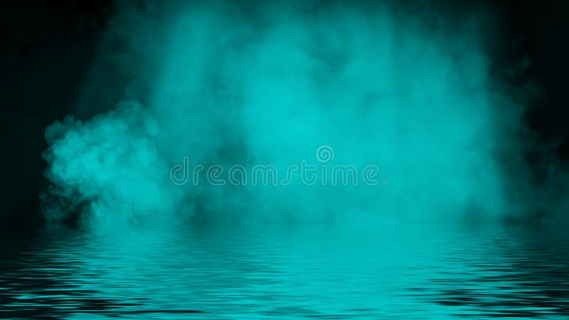 Azure spotlight smoke with reflection in water. Mistery fog texture overlays background. Design element. Azure spotlight smoke with reflection in water. Mistery stock photography