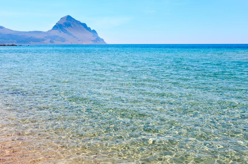 Monte Cofano mount view, Sicily, Italy. Azure Tyrrhenian sea picturesque bay and Monte Cofano mount view near Bue Marino Beach, Macari, San Vito Lo Capo region stock images