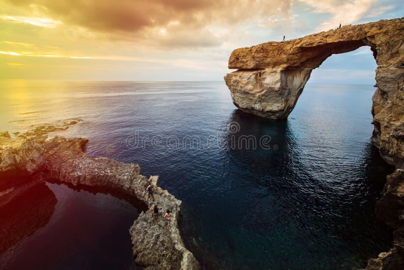 Azure window, Gozo island, Malta. Azure Window, natural arch, famous landmark and popular tourist spot, on Gozo island, Malta, Mediterranean, at dramatic sunset stock photo