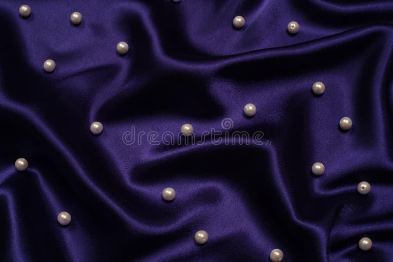 Azzurro di blu marino con la priorità bassa delle perle immagine stock