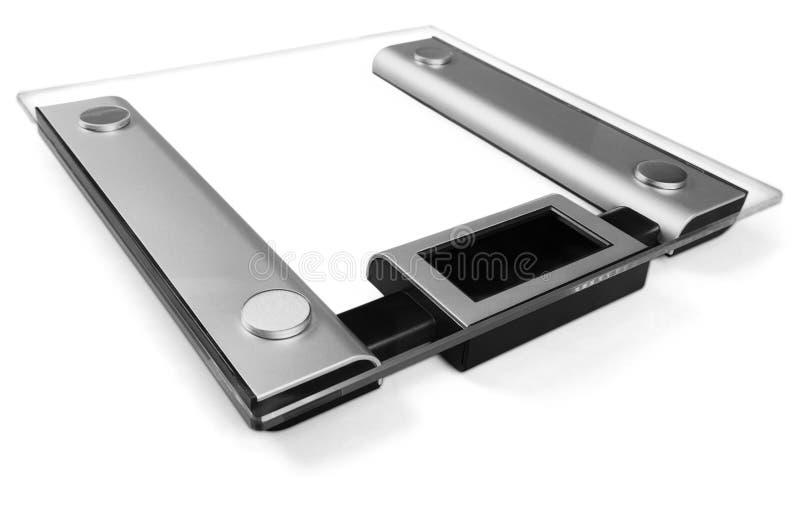 Báscula de baño en el fondo blanco foto de archivo libre de regalías