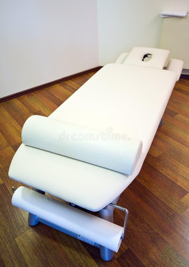 Bâti de massage photographie stock