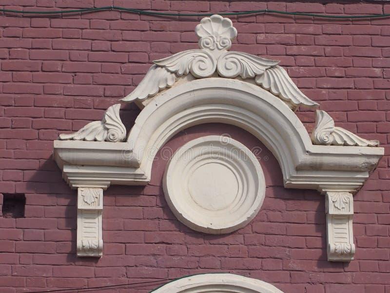 Bâti de stuc sur un mur de maison photographie stock libre de droits