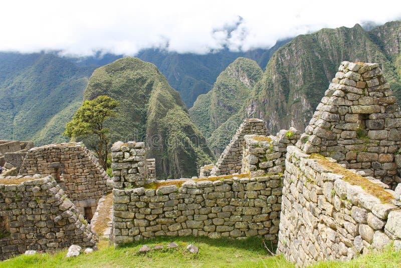 Bâtiments en pierre de Machu Picchu photographie stock libre de droits