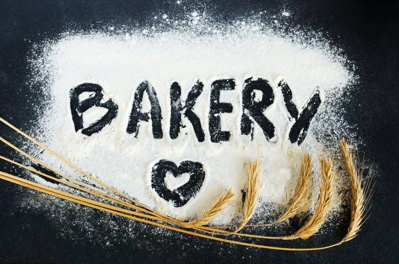 Bäckerei geschrieben auf Mehl stockfotografie
