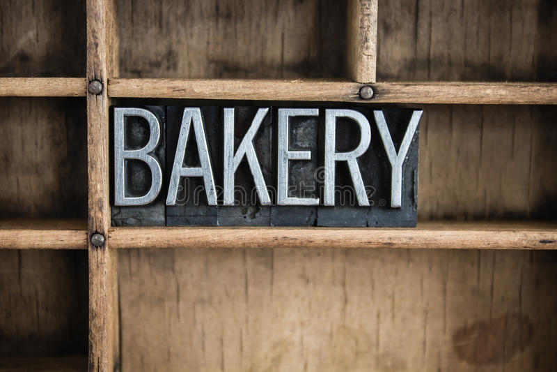 Bäckerei-Konzept-Metallbriefbeschwerer-Wort im Fach stockbilder
