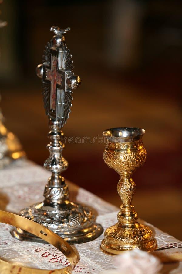 Bägare och kors royaltyfria foton