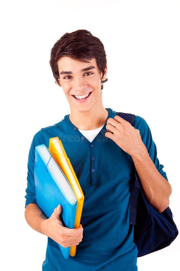 Bärande böcker för ung lycklig student royaltyfri foto