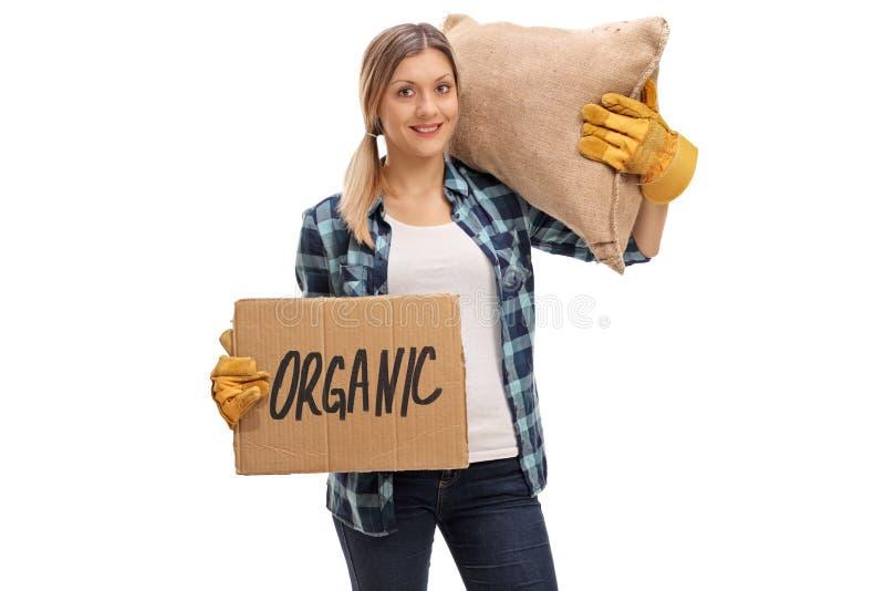 Bärande säck och innehav för bonde som en papp undertecknar arkivbilder