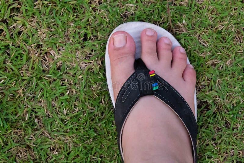 Bärande sandal för fot royaltyfri fotografi