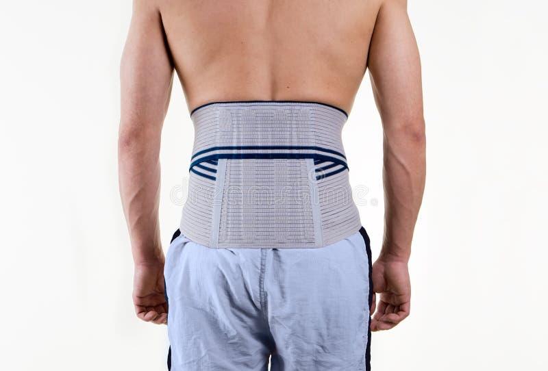 Bärande stag för Shirtless man som stöttar lägre baksida fotografering för bildbyråer