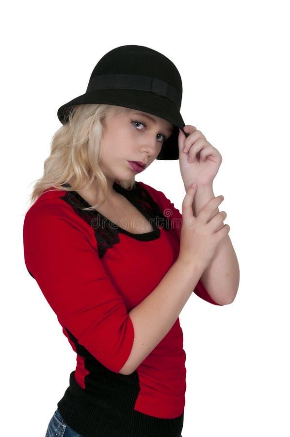 Bärande sticklingshushatt för kvinna fotografering för bildbyråer