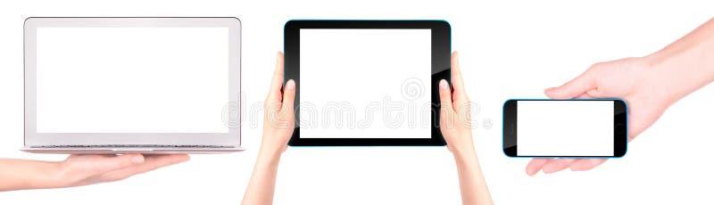 Bärbar dator, digital minnestavla och mobiltelefon med handen royaltyfria foton