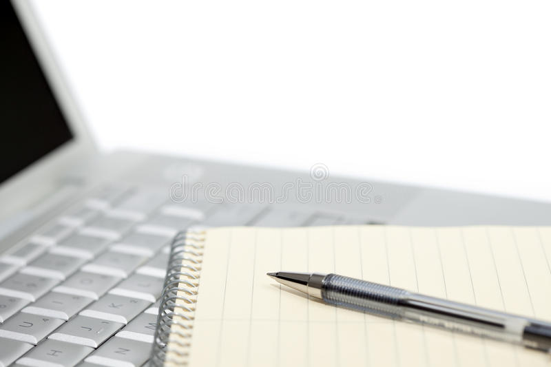 bärbar datoranteckningsbokpenna arkivbild