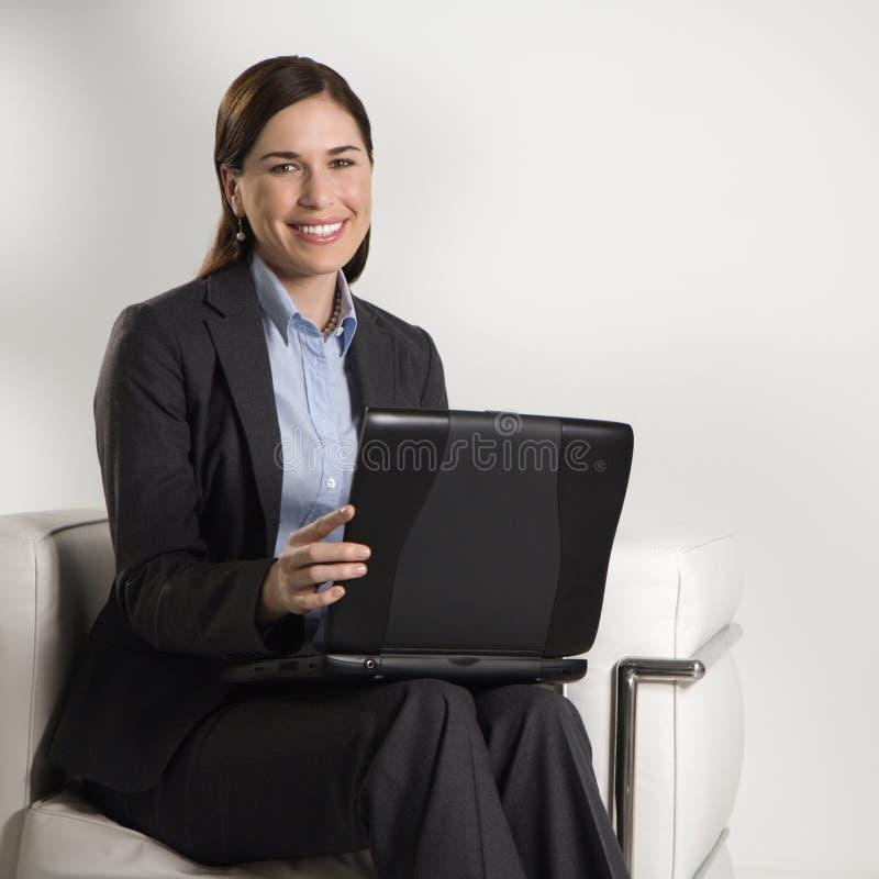 bärbar datorkvinna arkivfoto