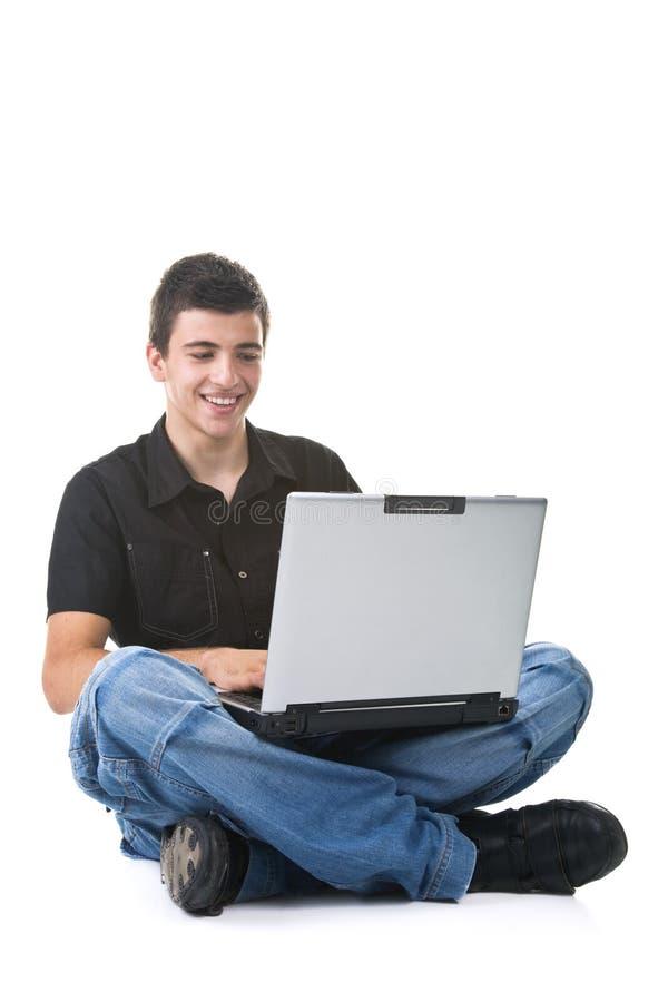 bärbar datorman som använder barn arkivfoton