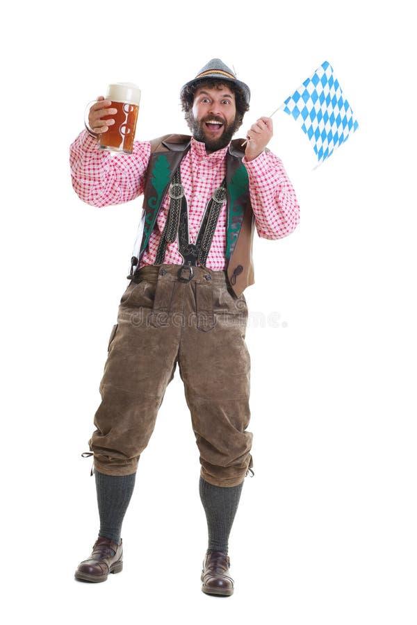 Bärtiger Kerl mit Bier und bayerischer Flagge stockbilder