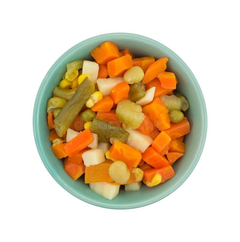 Bästa sikt av blandade grönsaker i en liten bunke royaltyfria foton