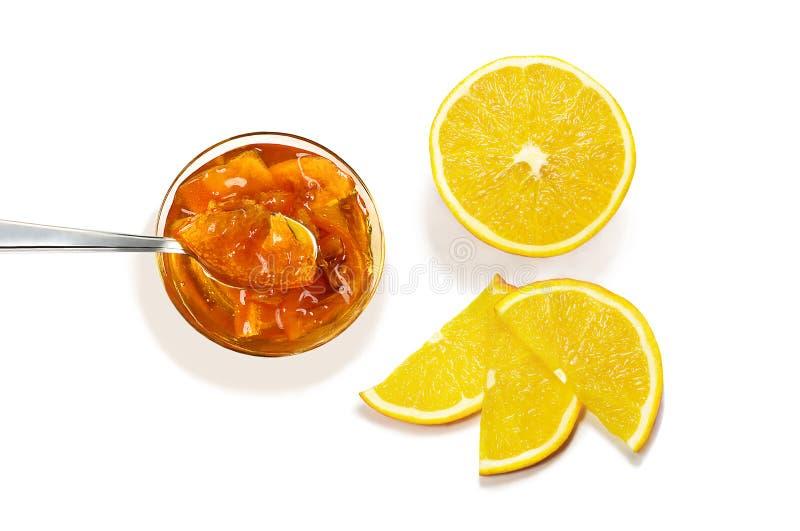 Bästa sikt av driftstopp med sked- och apelsinskivor royaltyfri fotografi