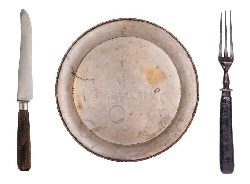 B?sta sikt av en platta, en gaffel och en kniv Tappningbestick bakgrund isolerad white fotografering för bildbyråer