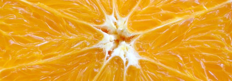Bästa sikt av ett fragment av det orange fruktskivaslutet upp Makro royaltyfri foto