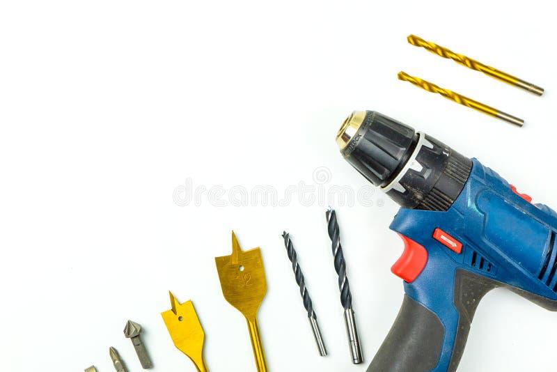 Bästa sikt av funktionsdugliga den konstruktionshjälpmedel, skruvmejseln och uppsättningen av dren arkivfoton