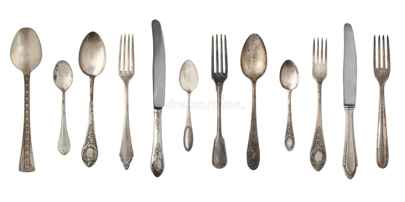 Bästa sikt av härliga tappningsilverknivar, skedar och gafflar som isoleras på vit bakgrund silverware royaltyfria bilder
