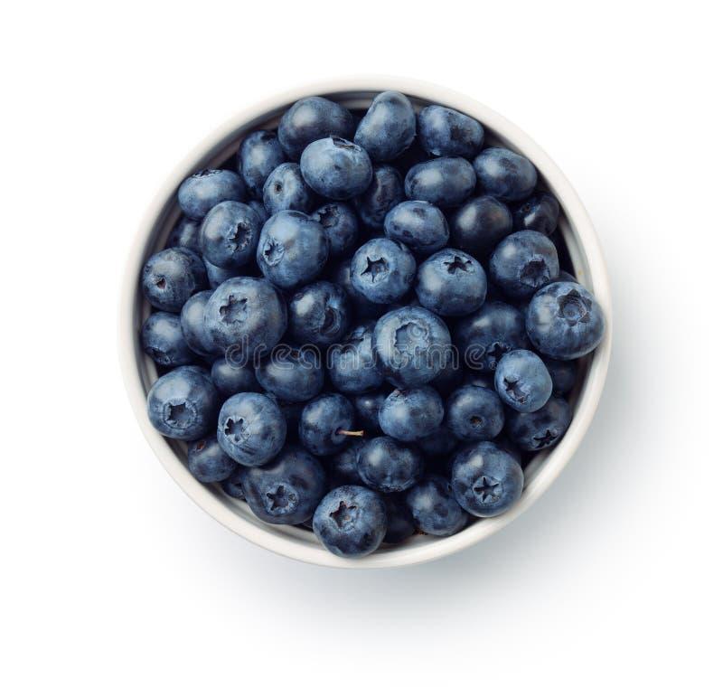 Bästa sikt av nya mogna blåbär i bunke royaltyfri fotografi