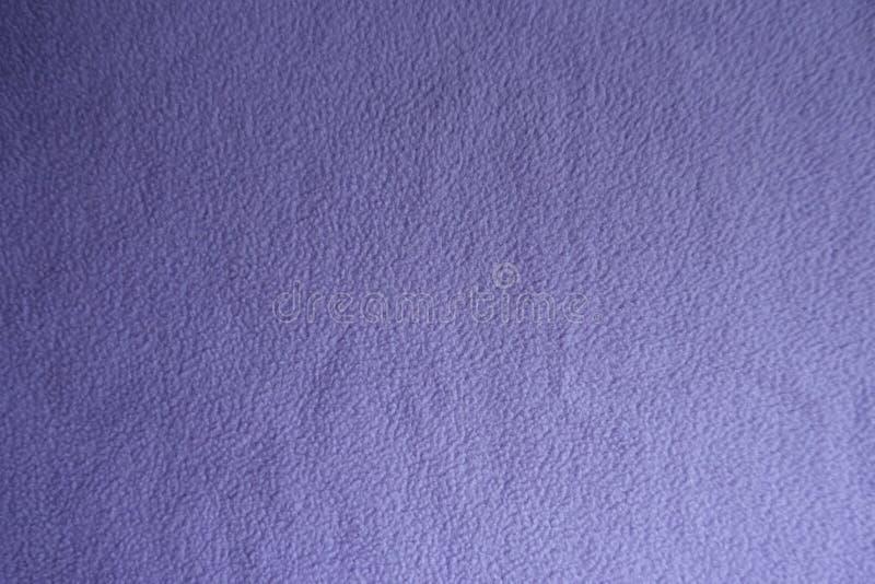 Bästa sikt av violett ullbeklädnadtyg royaltyfri fotografi