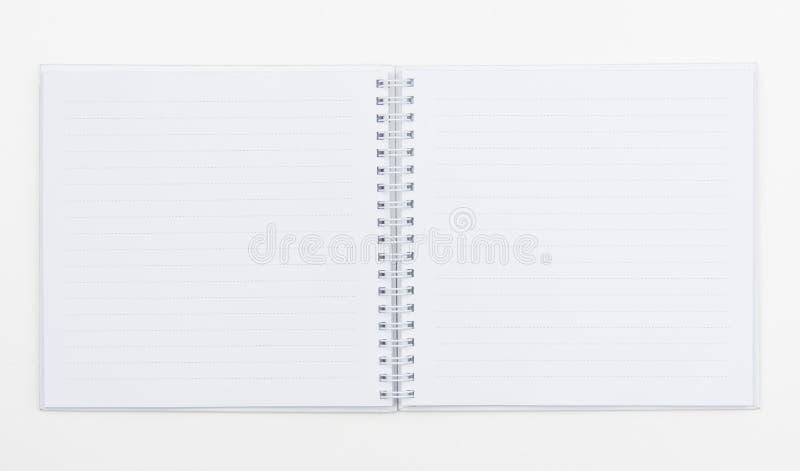 Bästa sikt av vitspiralboken på vit royaltyfria bilder
