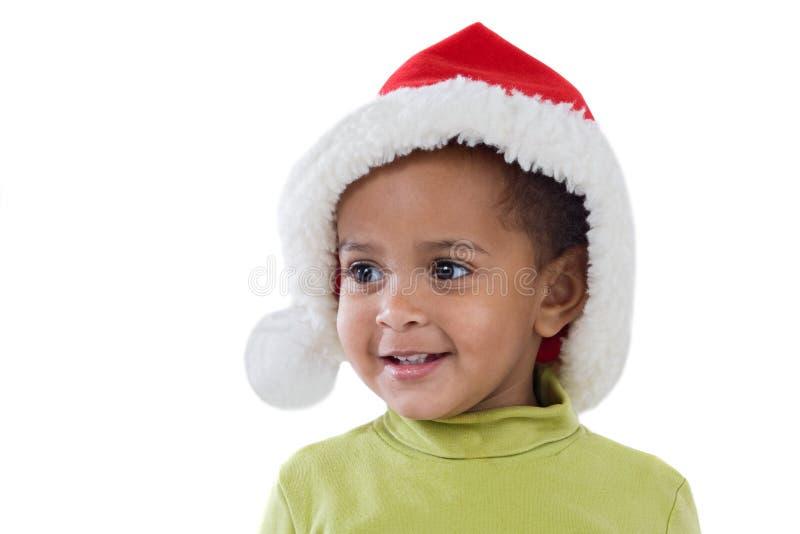 Bébé africain avec le chapeau rouge de Noël photographie stock