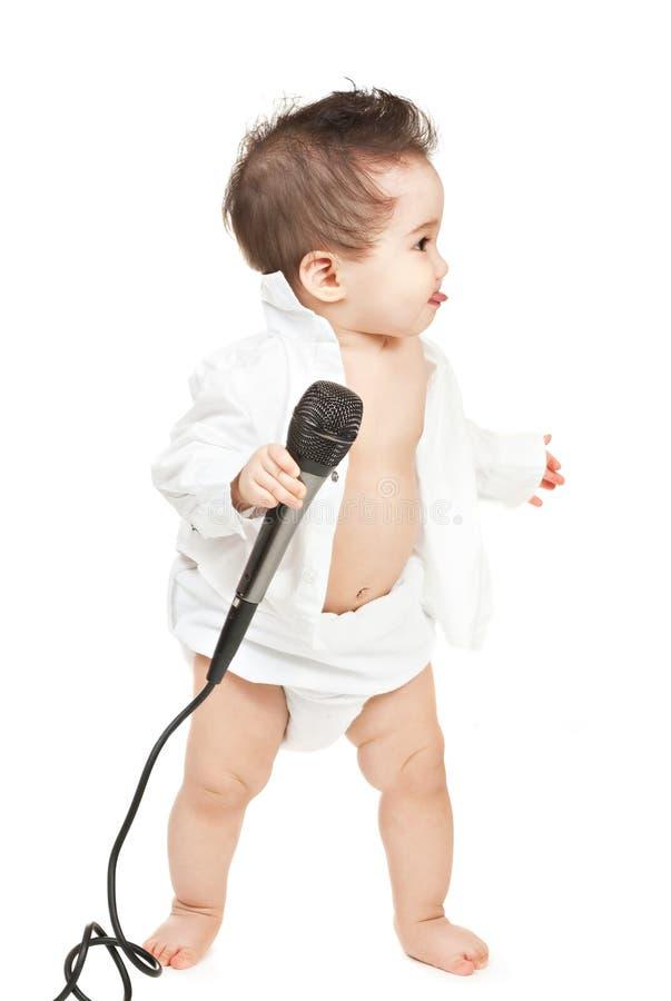 Bébé asiatique avec le microphone photos stock