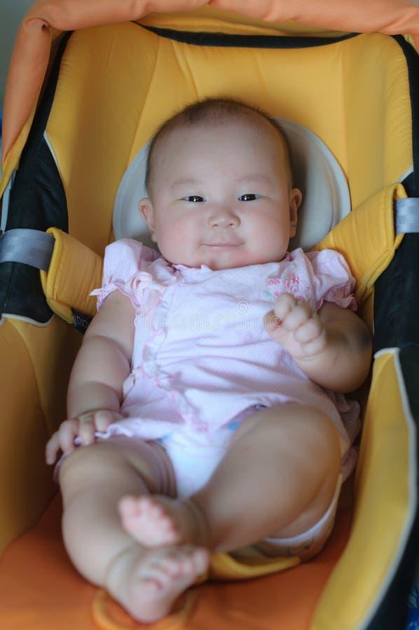 Bébé asiatique avec le sourire image stock