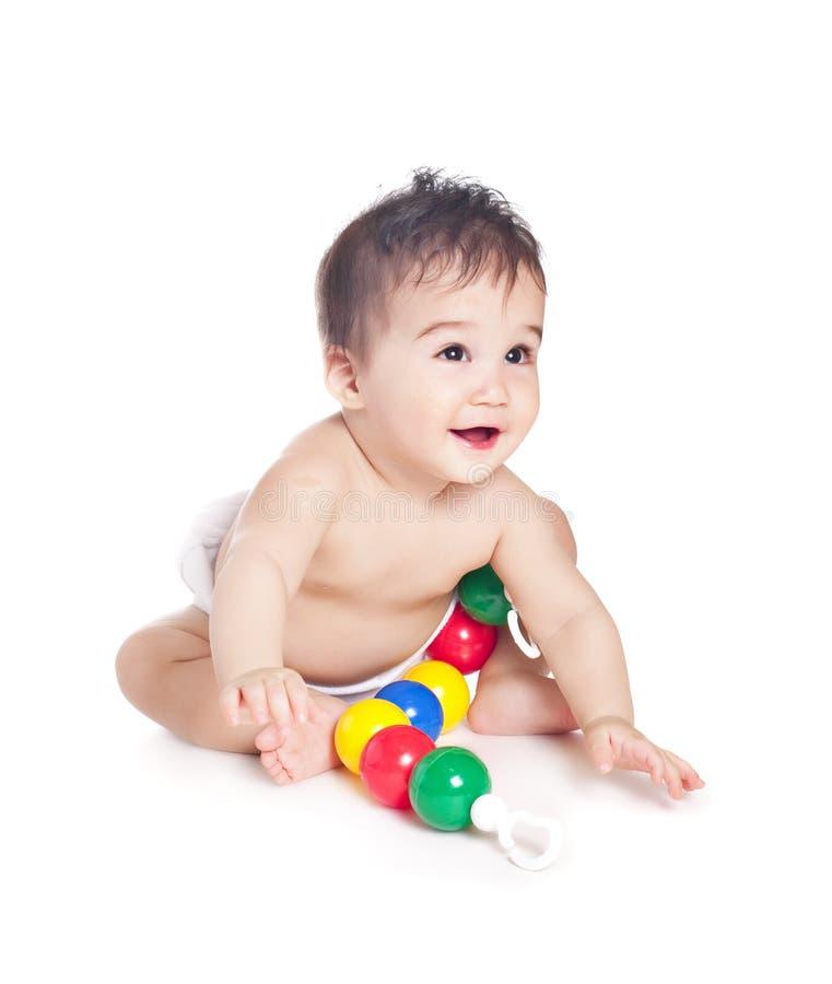 Bébé asiatique avec un jouet image stock