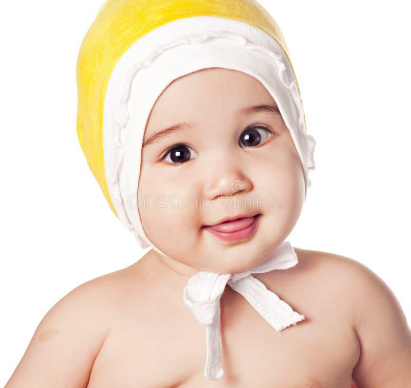 Bébé asiatique dans un capuchon jaune image libre de droits